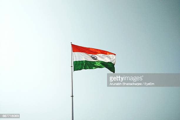 low angle view of the flag of india against clear sky - indian flag stock pictures, royalty-free photos & images