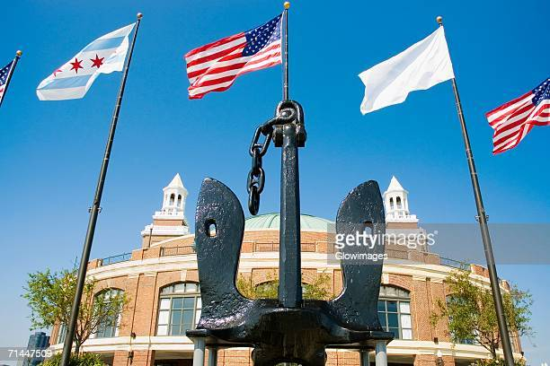 low angle view of the flags in front of a building, navy pier, chicago, illinois, usa - navy pier stock pictures, royalty-free photos & images
