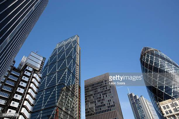 Low angle view of the Gherkin, Lloyds Building and the Cheesegrater, London, UK