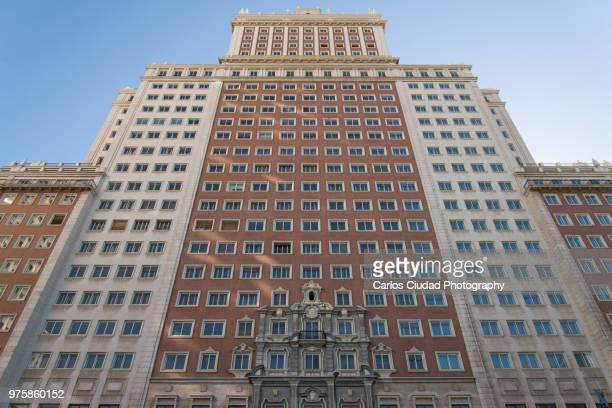 low angle view of the iconic 'spain building', madrid, spain - social history stock pictures, royalty-free photos & images