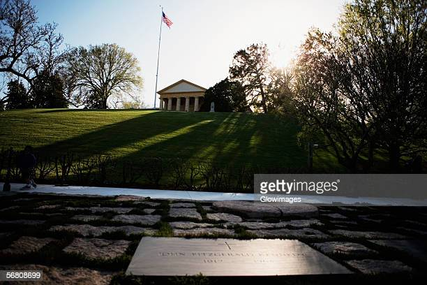 low angle view of the john kennedy grave and memorial, arlington house, arlington, virginia, usa - eternal flame stock photos and pictures
