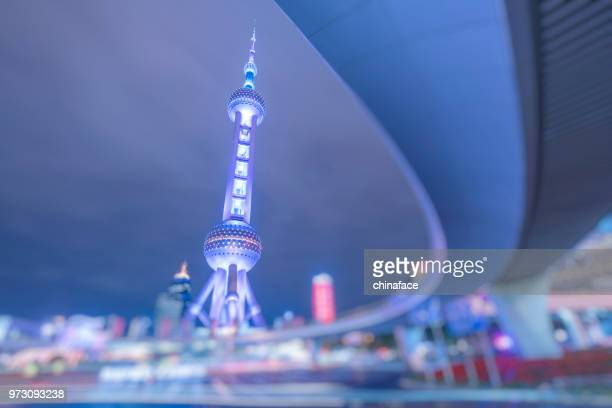 low angle view of the oriental pearl tower under footbridge in pudong,shanghai