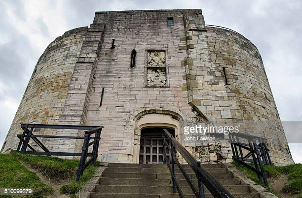 Low angle view of the ruins of the castle keep of York Castle, also called Clifford's Tower. York Castle is a medieval Norman stone structure dating...