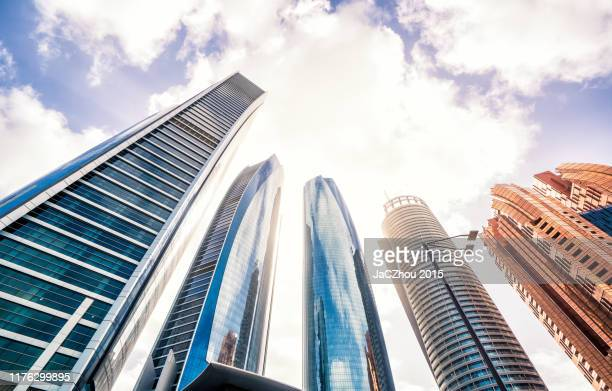 low angle view of the skyscrapers in abu dhabi - abu dhabi stock pictures, royalty-free photos & images