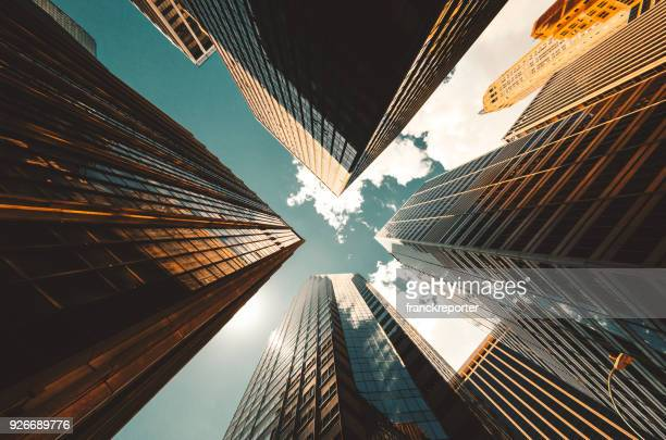 low angle view of the skyscrapers in nyc - financial district stock pictures, royalty-free photos & images