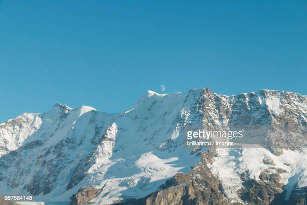 Low Angle View of the Snow-covered Alps and Moon, Swiss