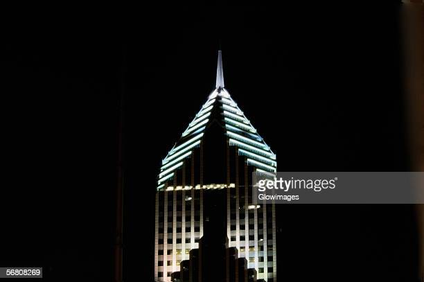 Low angle view of the top of a building lit up at night, Prudential Tower, Chicago, Illinois, USA
