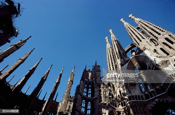 Low angle view of the towers of the Church of the Sagrada Familia, designed by architect Antoni Gaudi, in Barcelona, Spain, circa 1960.