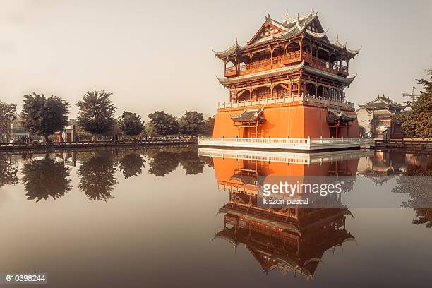 Low Angle View Of the traditional Chinese red temple with reflection in the lake