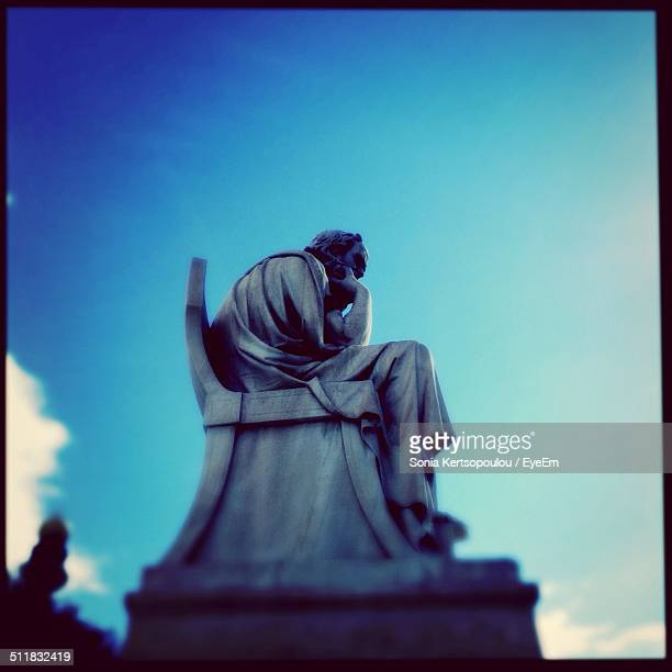 Low angle view of thinker sculpture