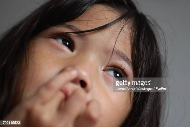 Low Angle View Of Thoughtful Girl Looking Away