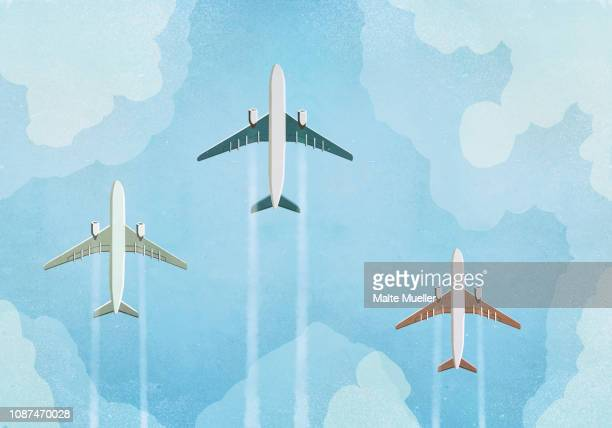 Low angle view of three airplanes flying in the sky