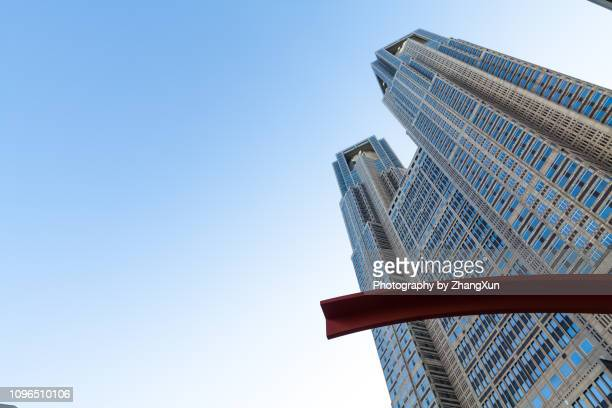 Low angle view of Tokyo Metropolitan Government building in Shinjuky ward with blue sky as background, Tokyo, Shinjyuku, Japan at day time.