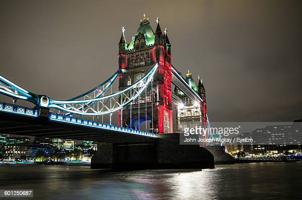 Low Angle View Of Tower Bridge Over River Against Sky At Dusk