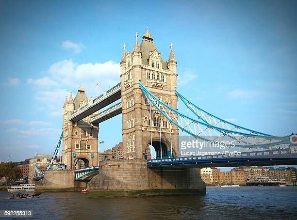 low angle view of tower bridge over thames river against sky - london bridge stock photos and pictures