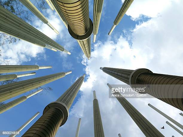 low angle view of towers against the sky - medellin colombia fotografías e imágenes de stock