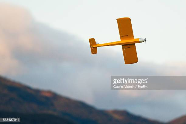 Low Angle View Of Toy Airplane Flying Against Sky