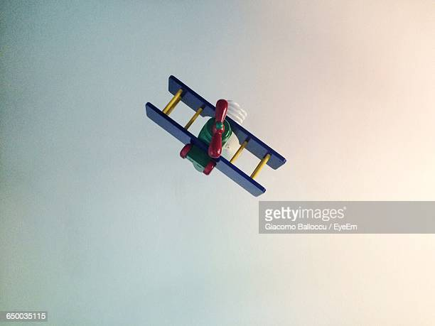 Low Angle View Of Toy Plane Flying Against Clear Sky