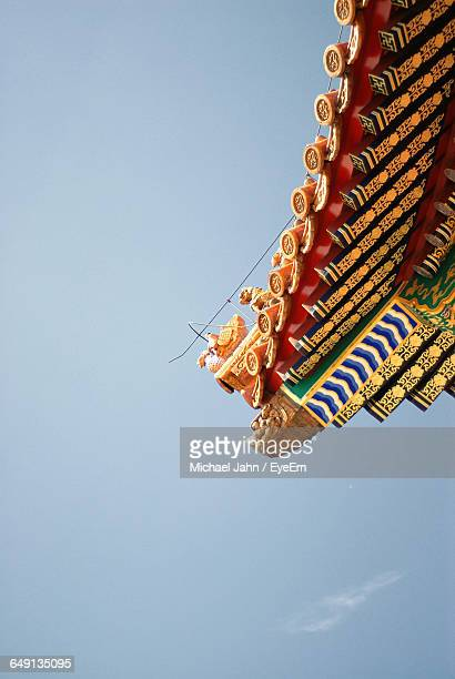 Low Angle View Of Traditional House Roof Against Sky