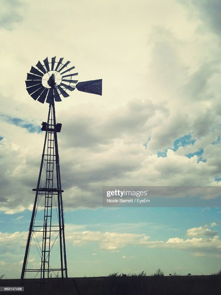 Low Angle View Of Traditional Windmill Against Sky : Stock Photo