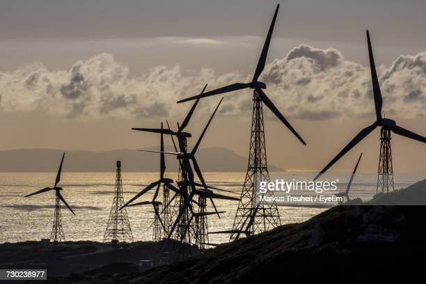 Low Angle View Of Traditional Windmill On Field Against Sky