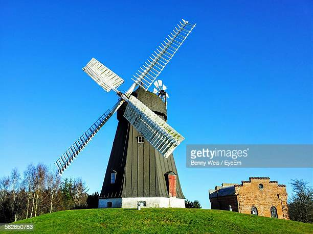 Low Angle View Of Traditional Windmill On Hill