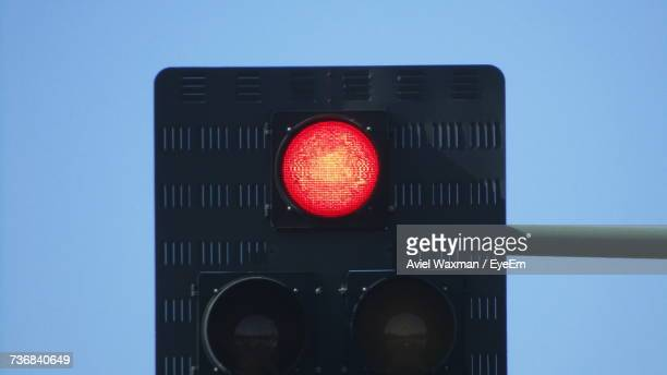 low angle view of traffic light against clear sky - red light stock pictures, royalty-free photos & images