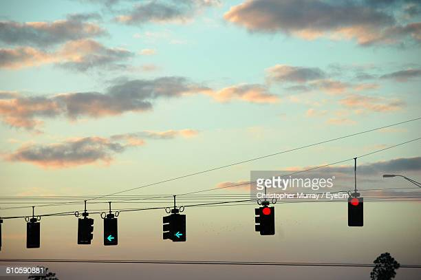 Low angle view of traffic lights against sky