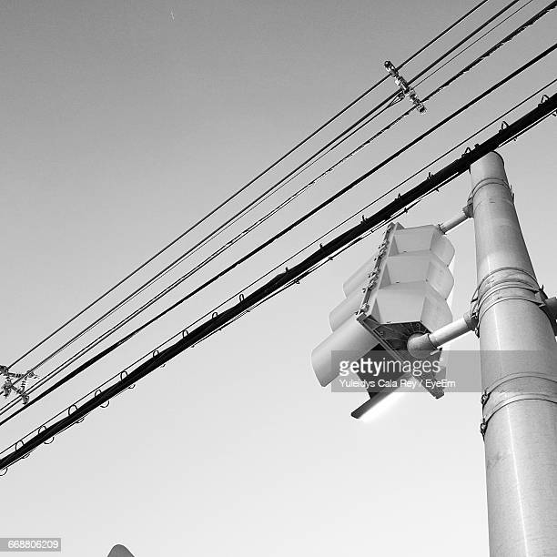 Low Angle View Of Traffic Lights And Electric Cables