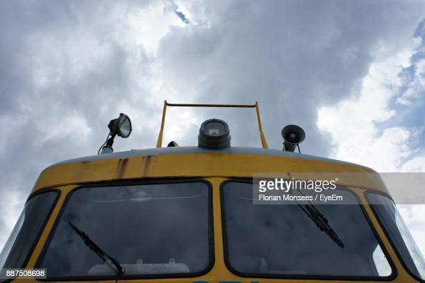 Low Angle View Of Train Against Cloudy Sky
