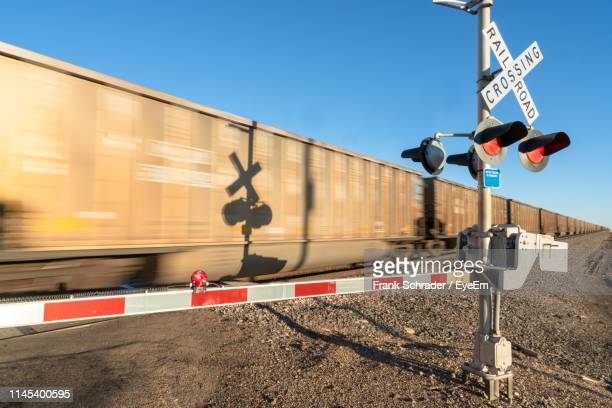 low angle view of train on railroad track against sky - frank schrader stock pictures, royalty-free photos & images