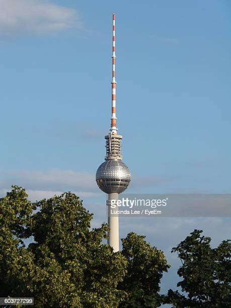 Low Angle View Of Trees And Fernsehturm Against Sky