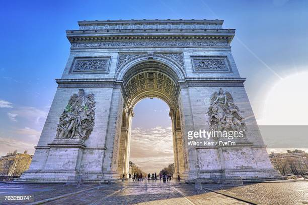 low angle view of triumphal arch - triumphal arch stock photos and pictures