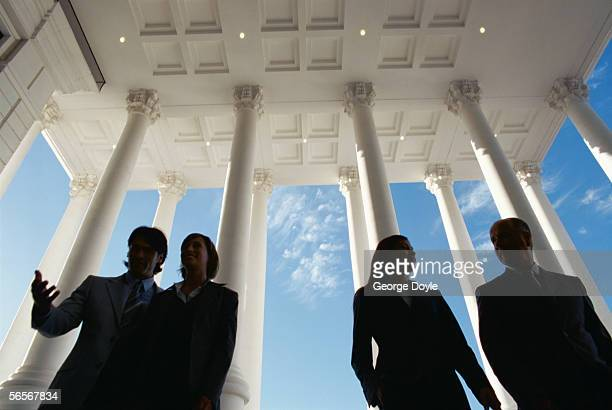 low angle view of two businessmen and two businesswomen