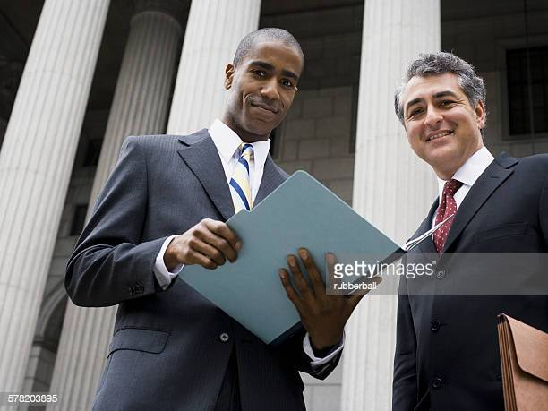 Low angle view of two lawyers smiling