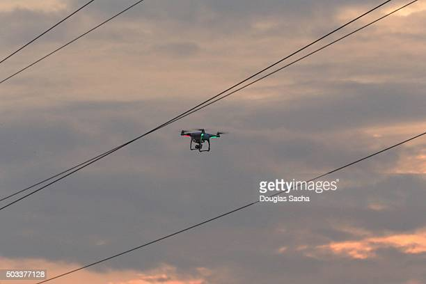 Low Angle View Of UAV drone fling near power lines