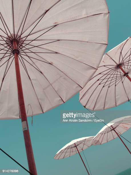 Low Angle View Of Umbrellas Against Clear Sky