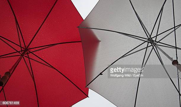 Low Angle View Of Umbrellas On Rainy Day