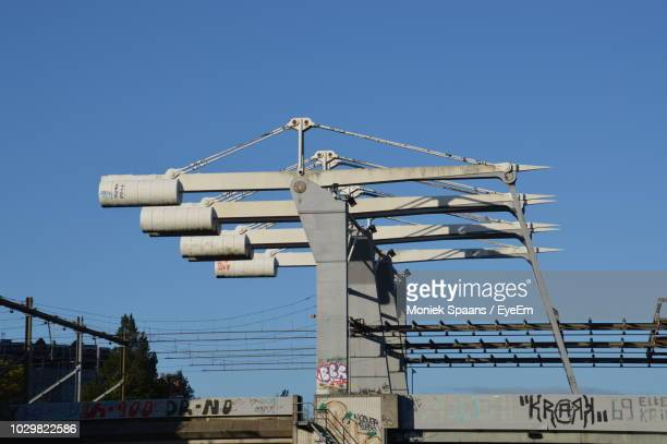 Low Angle View Of Under Construction Bridge Against Clear Blue Sky