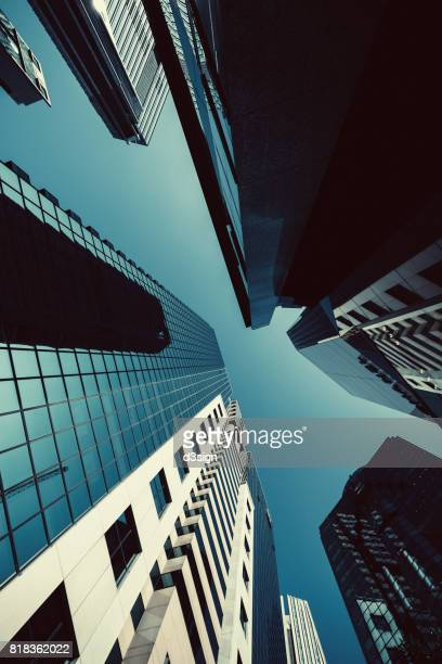 Low angle view of urban skyscrapers in Hong Kong Central Business District