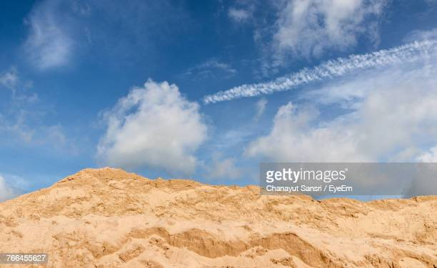 low angle view of vapor trail against blue sky - chanayut stock photos and pictures