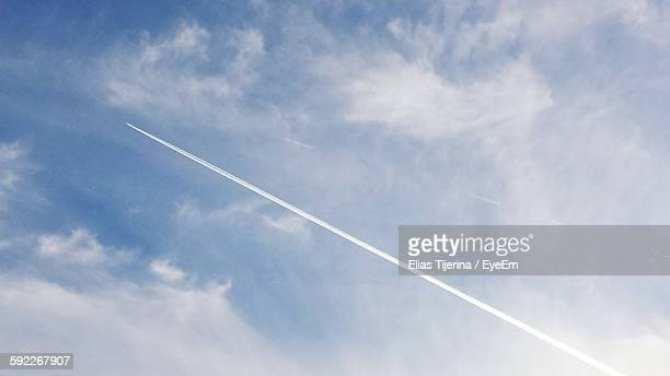 Low Angle View Of Vapor Trail In Cloudy Sky