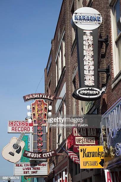 low angle view of various sign boards on building - nashville stock pictures, royalty-free photos & images