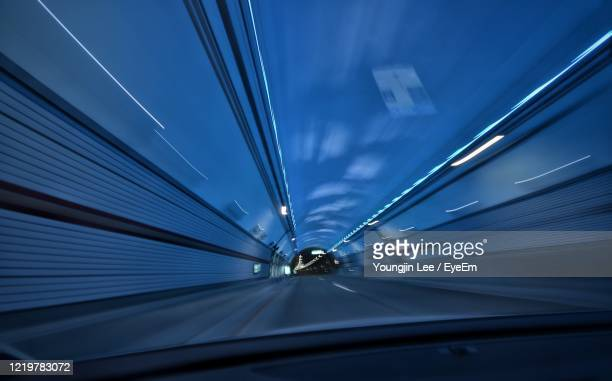 low angle view of vehicles on road - winter sports event stock pictures, royalty-free photos & images