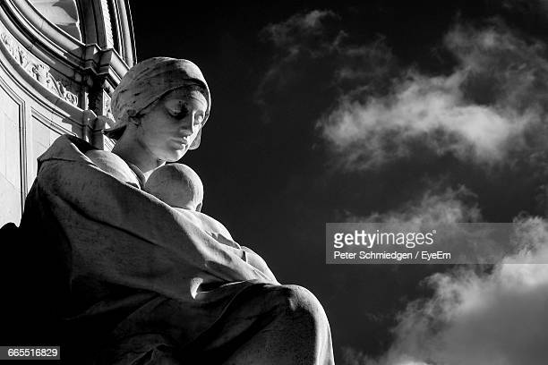 low angle view of virgin mary and jesus christ statue - virgin mary stock photos and pictures