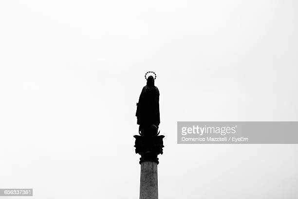 Low Angle View Of Virgin Mary Statue Against Clear Sky