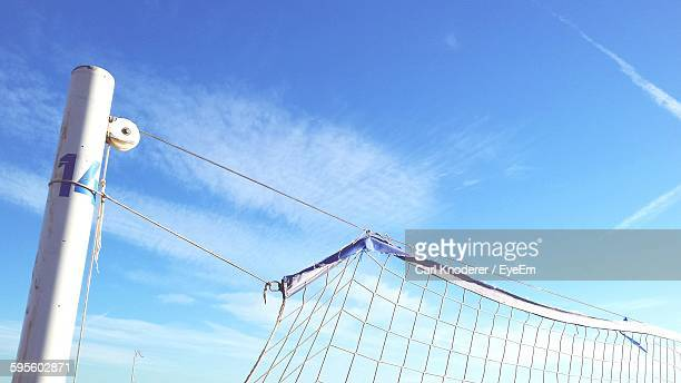 Low Angle View Of Volleyball Net Against Blue Sky