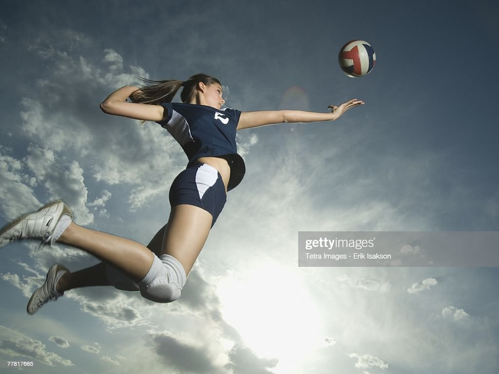 Low angle view of volleyball player jumping : Stock Photo