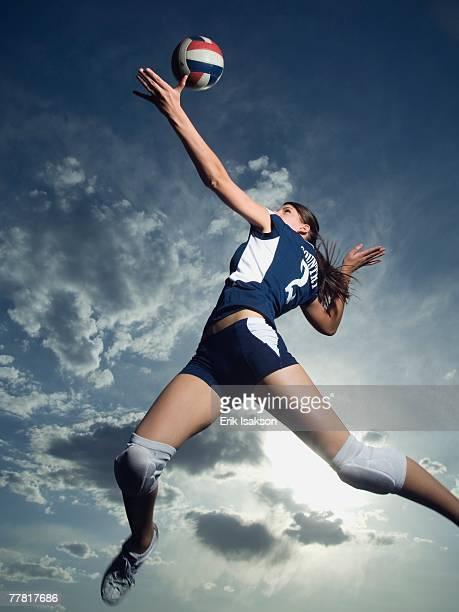 low angle view of volleyball player jumping - volleyballnetz stock-fotos und bilder