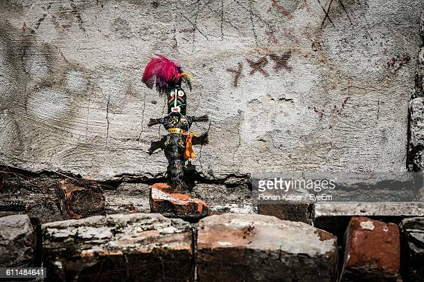 Low Angle View Of Voodoo Doll On Wall